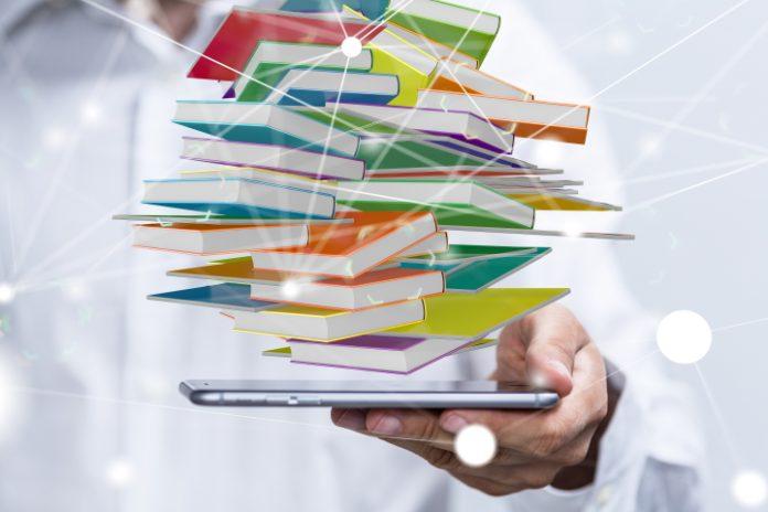 Afbeelding met boeken die uit een tablet komen